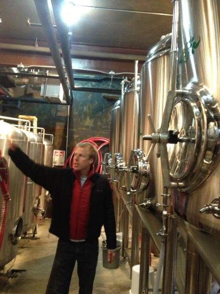 Luke showing Wicked Weed's fermenters