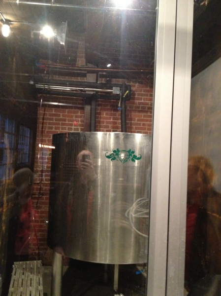 Open fermenter. He plans on hanging a big mirror overhead some that people can see it bubbling away.