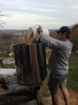Jerry pouring crushed grains into the Mashtun